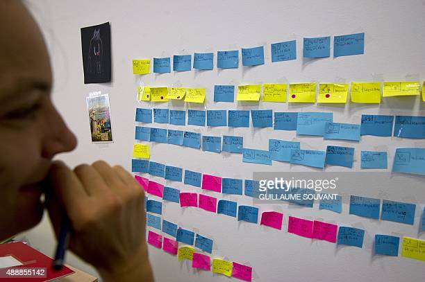 A movie director edits elements on a storyboard during the making of an animated movie using a rostrum camera on September 17 at the new French...