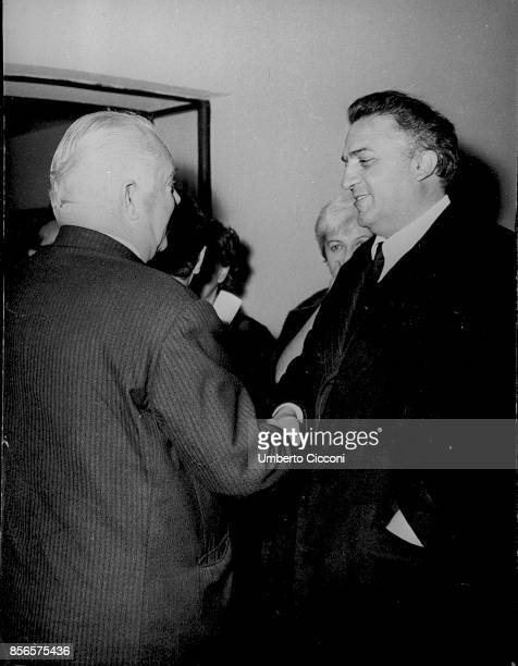 Movie director Federico Fellini shaking the hand of Achille D'Angelo in 1969