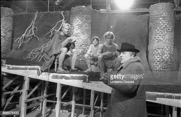 Movie director Federico Fellini with the actor Hiram Keller and two more actors while directing the movie Satyricon in 1969