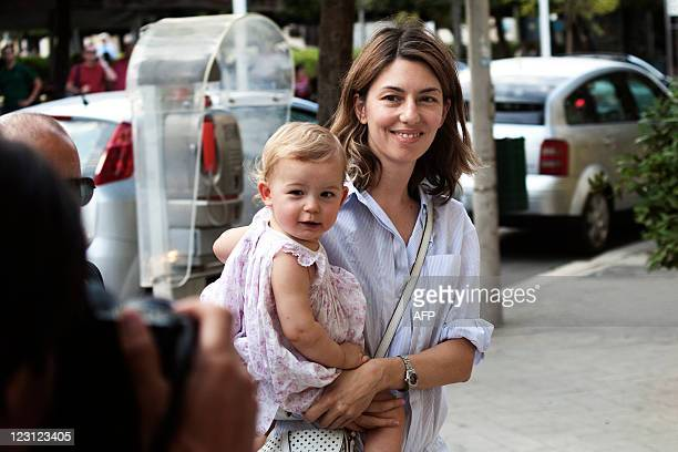 Movie director Sofia Coppola and her daughter Cosima walk through the streets of Bernalda on August 26 2011 Sofia Coppola is in the little city in...