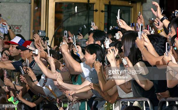 Movie fans take photos as members of the cast attend the Japan Premiere of Shrek 2 at Universal Studios Japan on July 15 2004 in Osaka Japan The film...