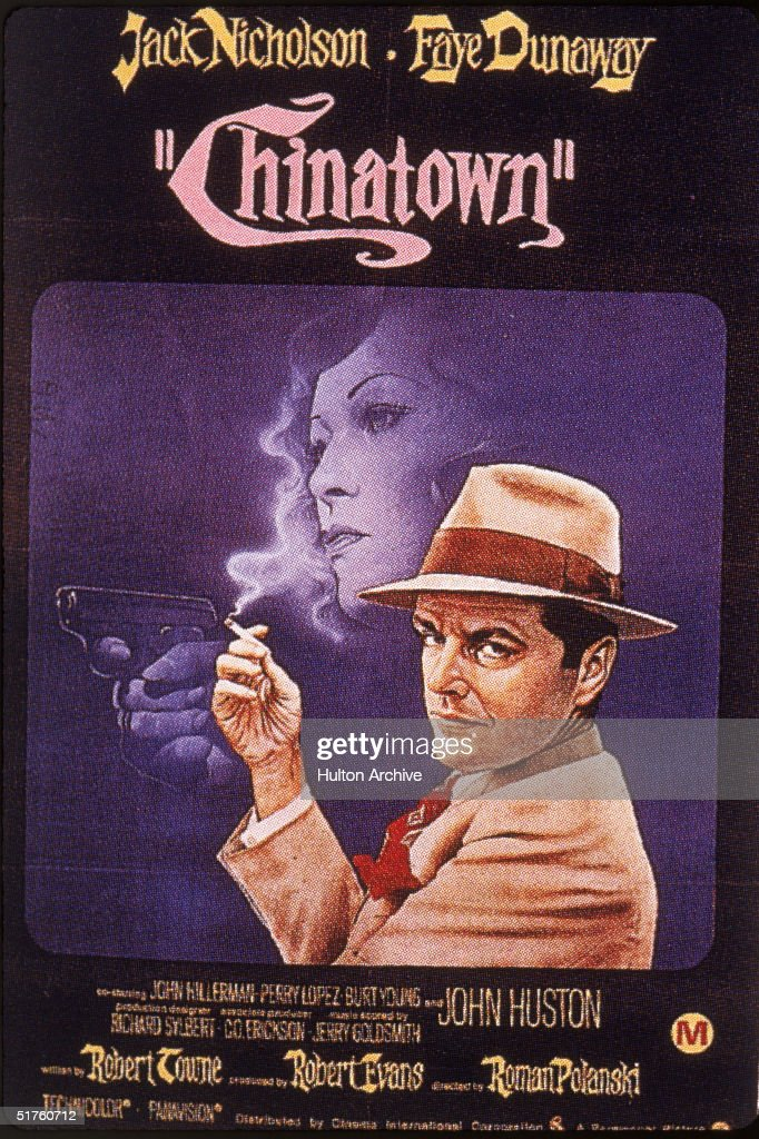 A movie poster for the Roman Polanski-directed film 'Chinatown' features American actor Jack Nicholson smoking a cigarette in front of a silhouette of actress Faye Dunaway holding a gun, 1974.
