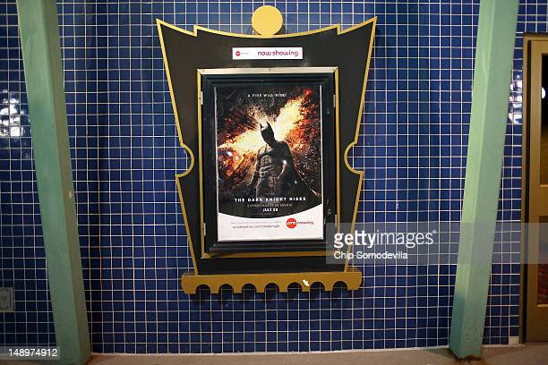 A movie poster hangs in a decorative frame outside the AMC Arapahoe Crossing 16 movie theater July 20 2012 in Aurora Colorado The AMC Arapahoe...