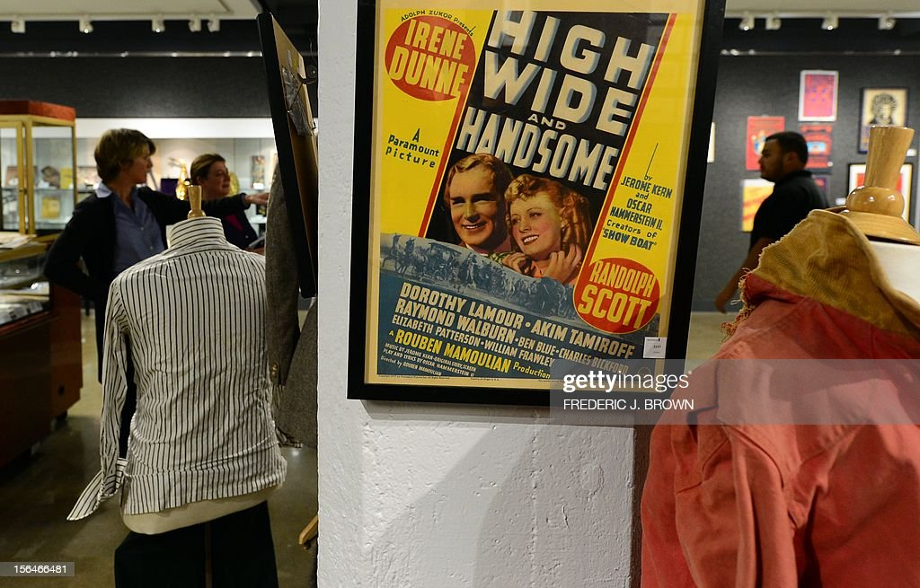 Movie posters, including this 1937 musical, are displayed during a press preview at auction house Bonham's in Hollywood, California, on November 15, 2012, where Charlie Chaplin's iconic bowler hat and cane are to go under the hammer in this weekend as part of an auction which also includes the John Lennon nude drawing of himself and Yoko Ono, part of the Lennon lot estomated between $18,000 and $22,000 , among memorabilia from other artists. The hat and cane trademark of Chaplin's Little Tramp character are in 'remarkable condition' and are estimated to go for between $40,000 and $60,000 at the sale by auction house Bonhams on Sunday November 18. AFP PHOTO / Frederic J. BROWN