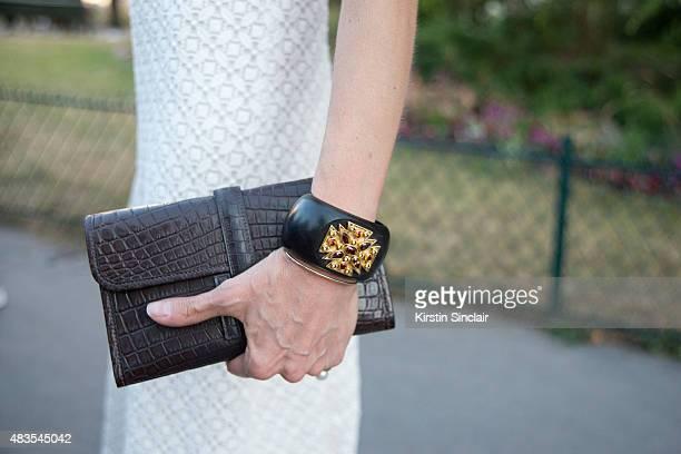 Movie Producer Allison Sarofim wears custom made Giambattista Valli dress Verdura cuffs and Hermes clutch bag on day 2 of Paris Fashion Week Haute...