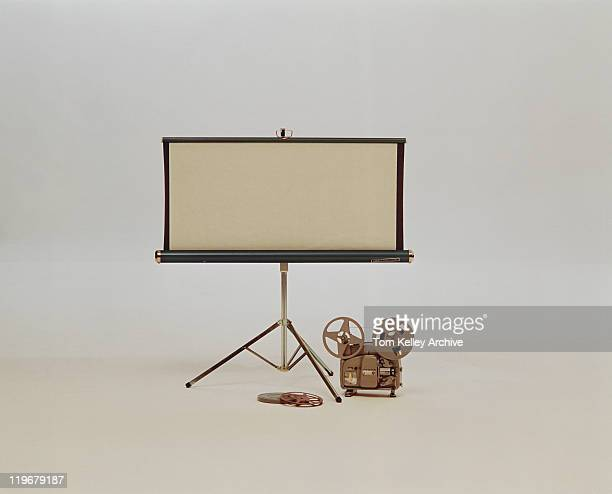 Movie projector and screen on white background