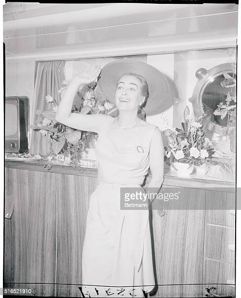 Movie star Joan Crawford smiles farewell aboard same ship She and husband Alfred N Steele left for an AfricanMideast safari She's been publicizing...