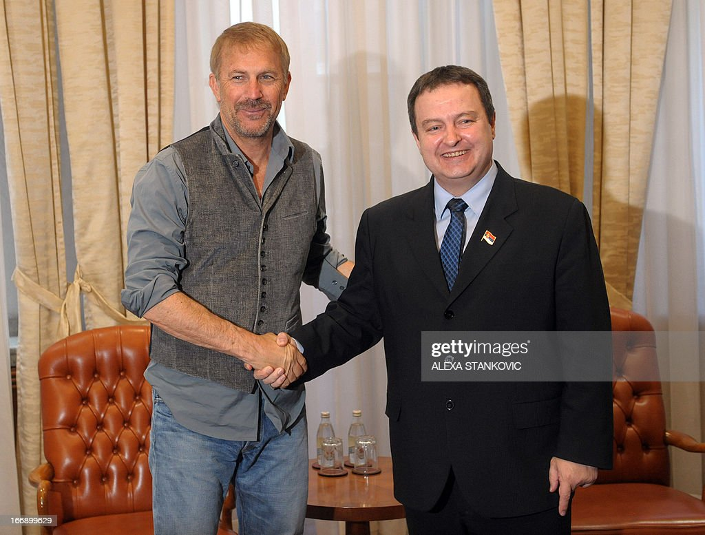 US movie star Kevin Costner (L) shakes hands with Serbian Prime Minister Ivica Dacic (R) prior to their meeting in Belgrade on April 18, 2013.