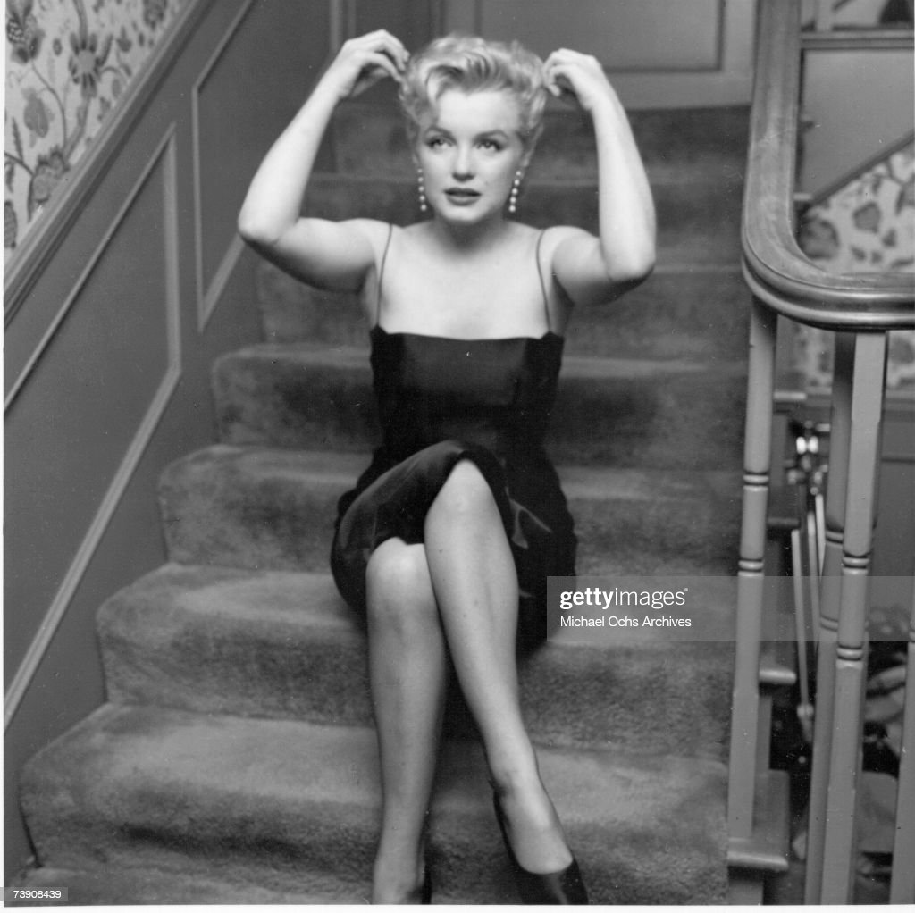 Movie star Marilyn Monroe hosts a press party held at her home on March 3, 1956 in Los Angeles, California.