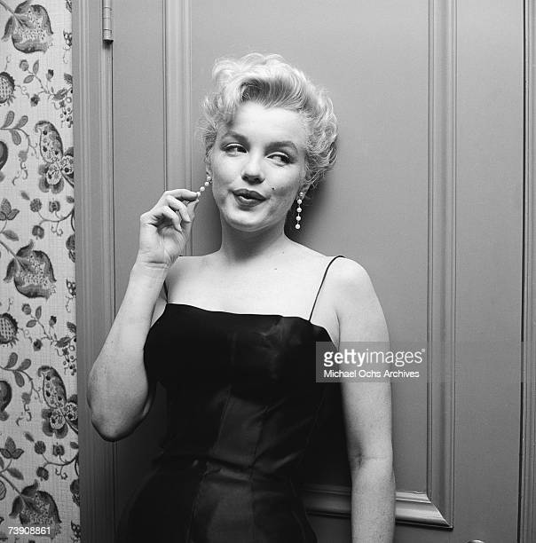 Movie star Marilyn Monroe hosts a press party held at her home on March 3 1956 in Los Angeles California