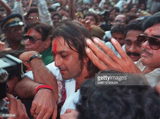 Movie star Sanjay Dutt is mobbed by fans as he walks out of the highsecurity Auther Road prison in Bombay 17 October after he was granted bail Dutt...