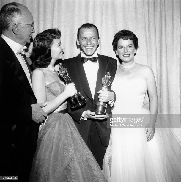 Movie stars Donna Reed and Frank Sinatra hold their Oscars which they won for Best Supporting Actress and Best Supporting Actor respectively in the...
