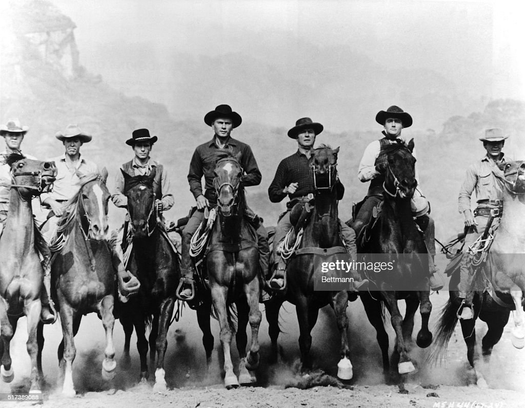 A movie still from The Magnificent Seven features the seven principal characters on horseback. The actors and their characters are (from left to right): Steve McQueen as Vin; James Coburn as Britt; Horst Buchholz as Chico; Yul Brynner as Chris Adams; Brad Dexter as Harry Luck; Robert Vaughn as Lee; Charles Bronson as Bernardo O'Reilly.