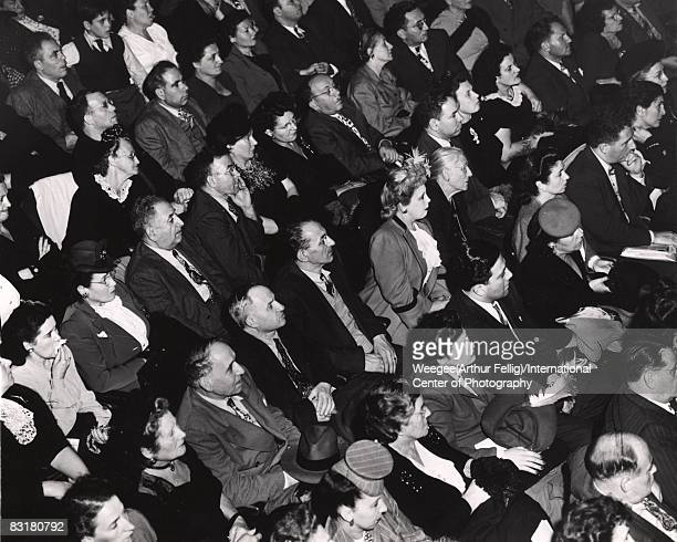 A movie theater or opera audience sits in rapt attention during a performance New York ca1940s Photo by Weegee/International Center of...