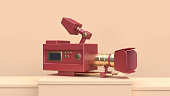movie-cinema camera red gold set on cream scene 3d rendering