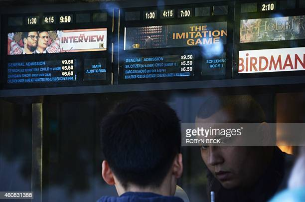 A moviegoer speaks with the ticket seller at the Los Feliz 3 cinema in Los Angeles California where 'The Interview' opened on December 25 2014 Some...