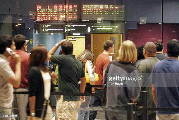 Moviegoers are seen line up to buy tickets for the new Superman Returns movie on June 27 2006 in Chicago Illinois The theater had a special showing...