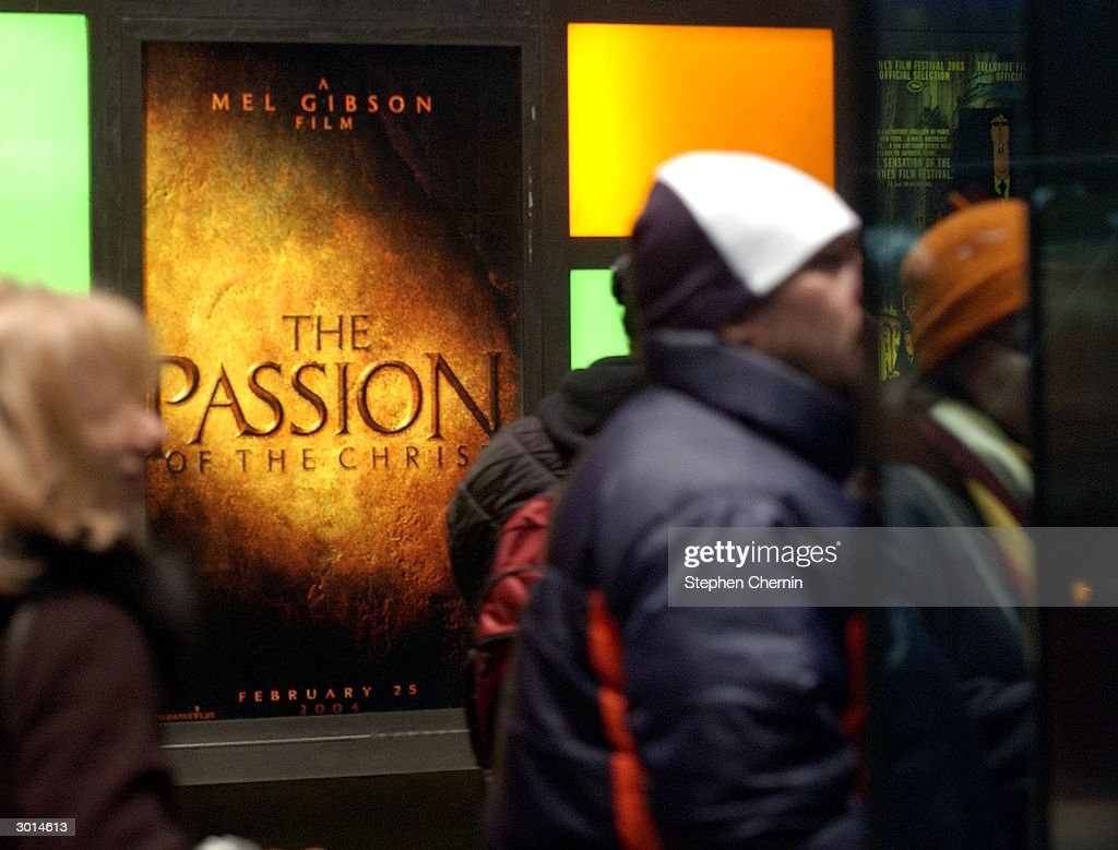Movie-goers wait in line in front of a advertisement for Mel Gibson's The Passion of the Christ at a theater February 25, 2004 in New York CIty.'The Passion of the Christ' opened in cinemas across the country as many Jewish groups pinned it as anti-Semitic.