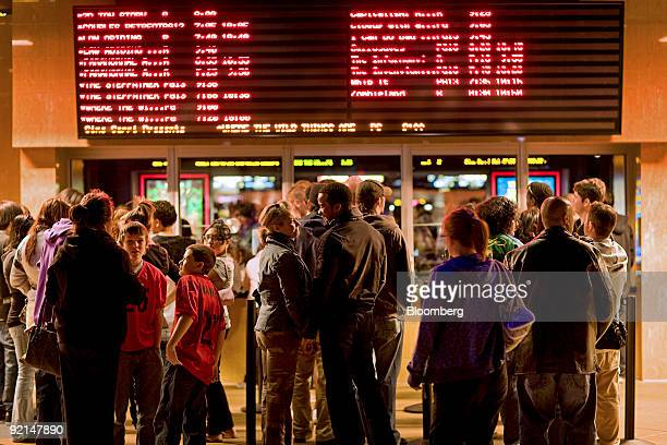 Moviegoers wait in line to buy tickets at a Harkins movie theater in Denver Colorado US on Friday Oct 16 2009 Yeartodate receipts for movie sales...