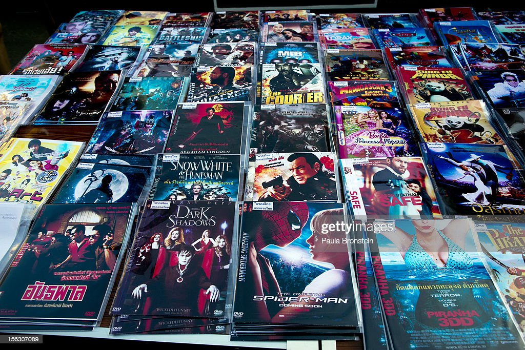 Movies copied onto DVDs are displayed for sale at an outdoor market selling counterfeit Chinese made items in the Golden Triangle situated along the...
