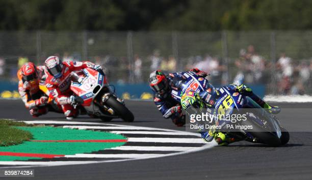 Moviestar Yamaha Valentino Rossi leads Vinales and Dovizioso in the opening laps during the British Moto Grand Prix at Silverstone Towcester