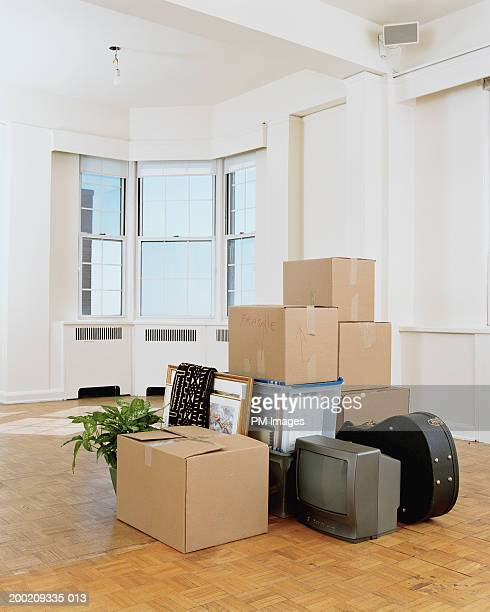 Moving boxes and belongings in apartment