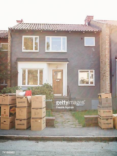 Moving boxes outside a house.