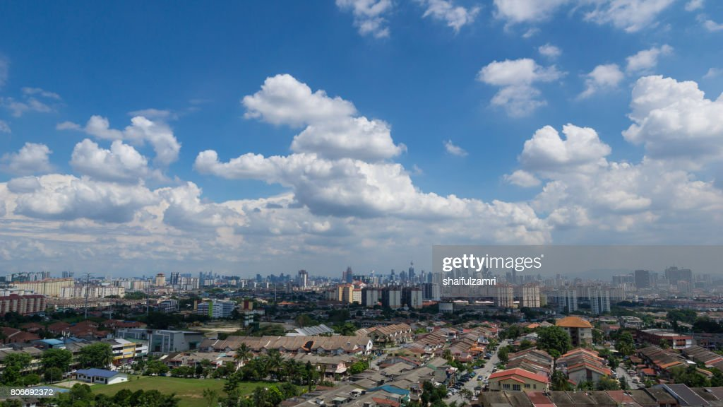 Moving clouds over downtown Kuala Lumpur, Malaysia : Stock Photo