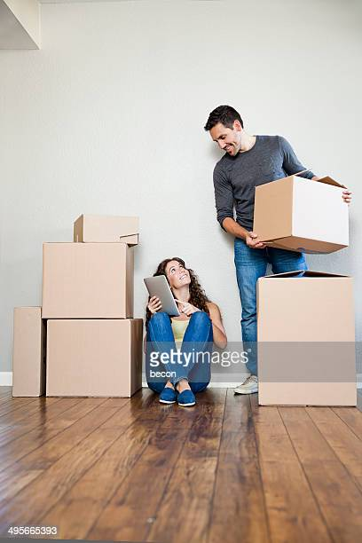 Moving Couple with Tablet
