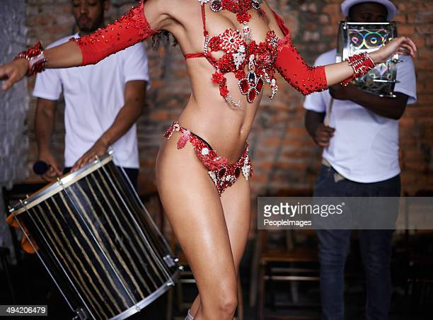 Moving her hips to the samba beat
