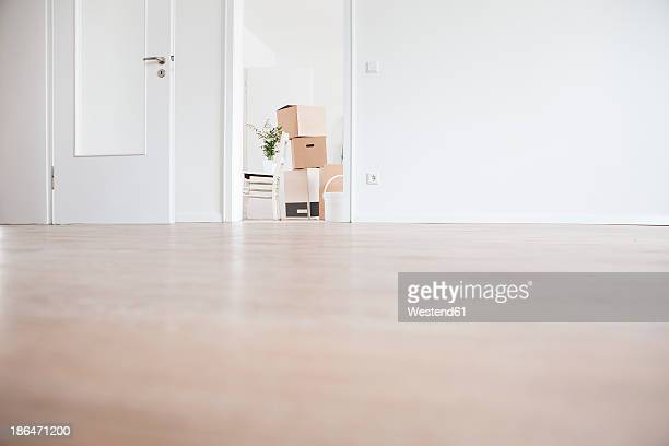 Moving house with box and chair in background