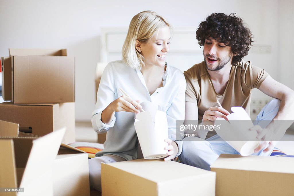 Moving into a new home and eating takaway. : Stock Photo