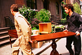 Moving men carrying table