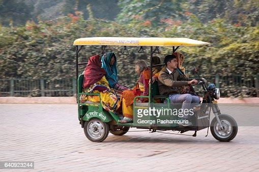 Moving rickshaw near Taj Mahal, India