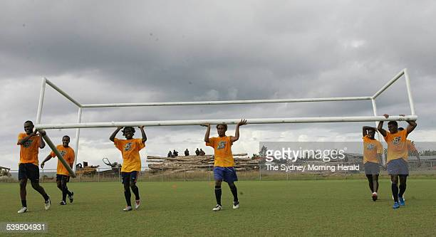 Moving the goalposts The Solomon Island players move the post during practise for Saturday's match against Australia 7 October 2004 SMH Picture by...