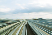 Moving train track curved motion, skyline abstract background