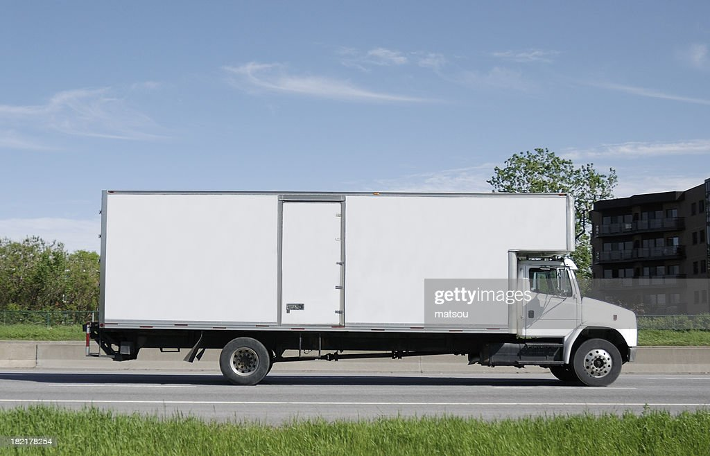 Moving truck on road.