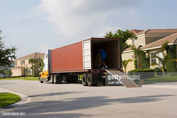 Moving truck parked in front of house