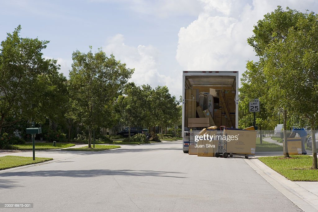 Moving truck parked on street