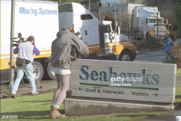 Moving vans drive into the Seattle Seahawks' headquarters in Kirkland Washington 04 February as unidentified media shoot their arrival The team is...