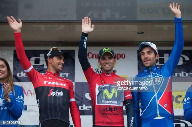 Movistar Spanish cyclist Alejandro Valverde celebrates his victory between second placed TrekSegafredo Spanish cyclist Alberto Contador and third...