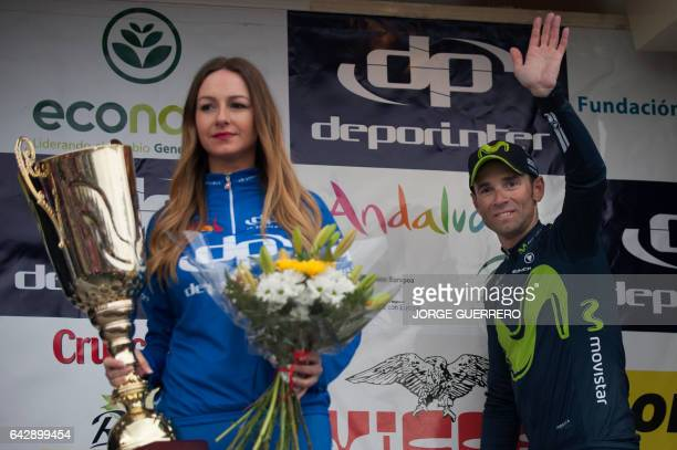 Movistar Spanish cyclist Alejandro Valverde celebrates on the podium after winning the 'Ruta del Sol' tour in Coin on February 19 2017 / AFP / JORGE...