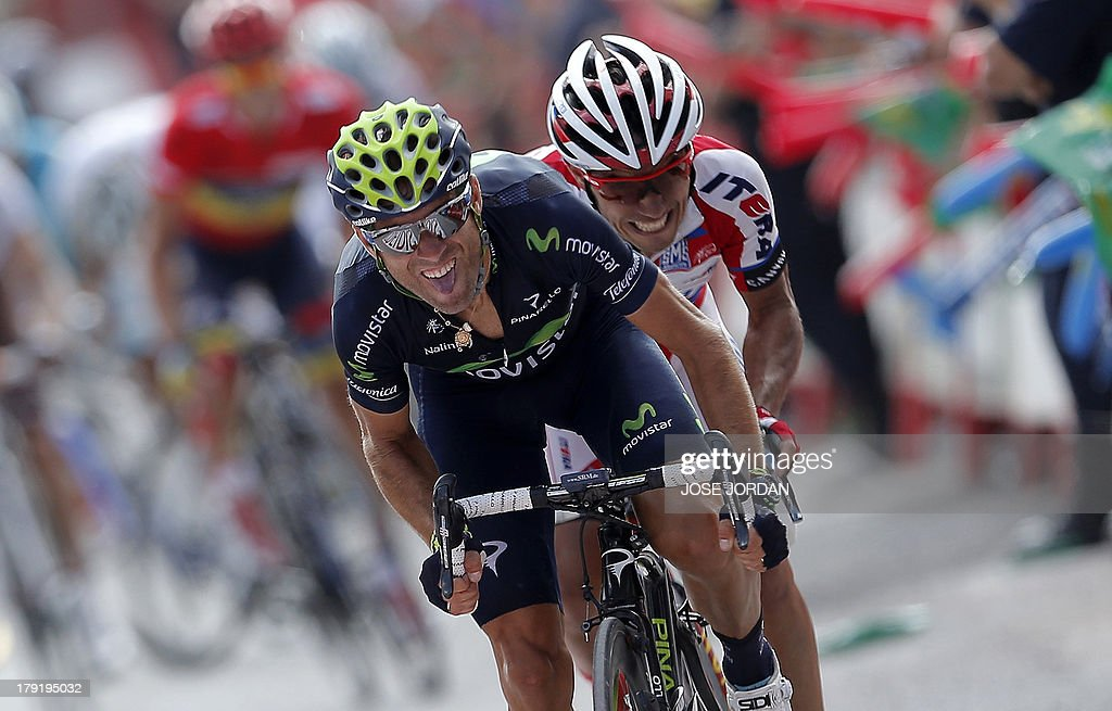 Movistar team Alejandro Valverde (L) and Katusha Joaquin Rodriguez 'Purito' ride on September 1, 2013 during the nineth stage of the 68th edition of 'La Vuelta' Tour of Spain, a 163.7 km route between Antequera and Valdepenas de Jaen. Spaniard Daniel Moreno (Katusha) edged out compatriots Alejandro Valverde (Movistar) and Joaquim Rodriguez (Katusha) by four seconds with overnight leader Nicholas Roche (Saxo) finishing fourth, eight seconds behind.