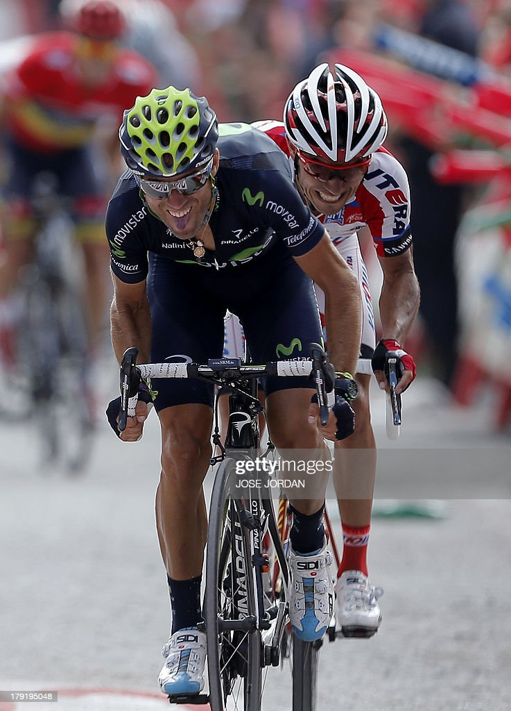 Movistar team Alejandro Valverde (L) and Katusha Joaquin Rodriguez 'Purito' ride on September 1, 2013 during the nineth stage of the 68th edition of 'La Vuelta' Tour of Spain, a 163.7 km route between Antequera and Valdepenas de Jaen. Spaniard Daniel Moreno (Katusha) edged out compatriots Alejandro Valverde (Movistar) and Joaquim Rodriguez (Katusha) by four seconds with overnight leader Nicholas Roche (Saxo) finishing fourth, eight seconds behind. AFP PHOTO/ JOSE JORDAN
