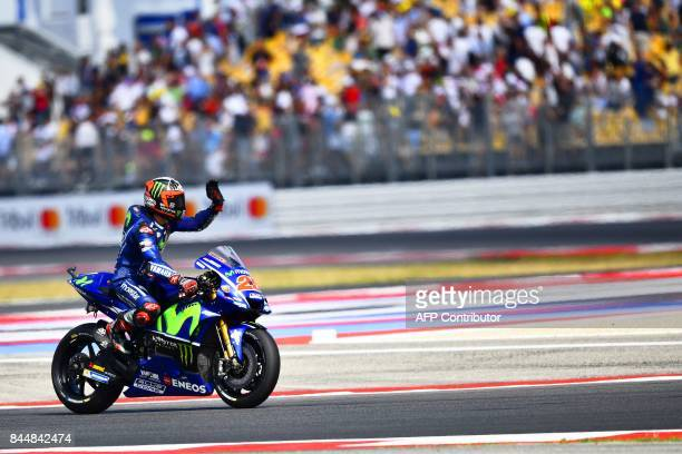 Movistar Yamaha Moto GP's spanish rider Maverick Vinales waves to the public after grabbing pole position for the San Marino Moto GP Grand Prix race...