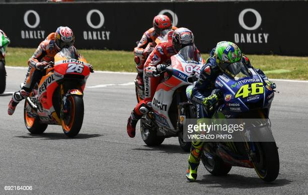 Movistar Yamaha MotoGP rider Italian Valentino Rossi Ducati's Team rider Italian Andrea Dovizioso and Repsol Honda Team rider Spanish Dani Pedrosa...