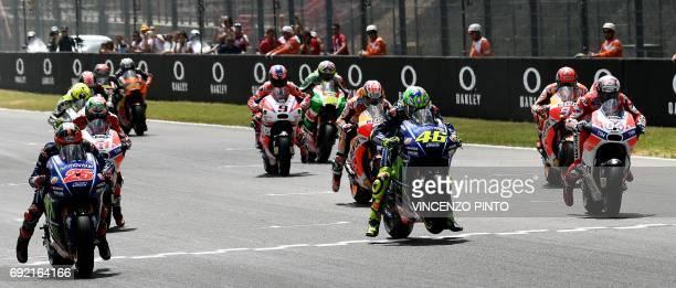 Movistar Yamaha MotoGP rider Italian Valentino Rossi Ducati's Team rider Italian Andrea Dovizioso and Movistar Yamaha Moto GP rider Spanish Maverick...