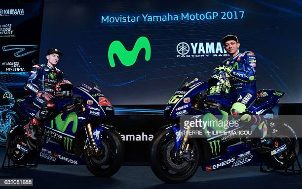 Movistar Yamaha MotoGP Team's riders Spanish Maverick Vinales and Italian Valentino Rossi pose seated on their Yamaha YZR M1 in Madrid on January 19...