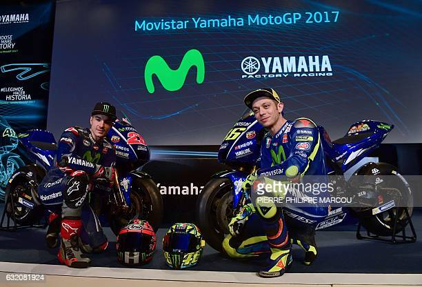 Movistar Yamaha MotoGP Team's riders Spanish Maverick Vinales and Italian Valentino Rossi pose in front of their Yamaha YZR M1 in Madrid on January...
