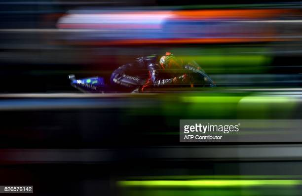 TOPSHOT Movistar Yamaha MotoGP Team's Spanish rider Maverick Vinales rides his Yamaha during a free practice session of the Moto GP Grand Prix of the...